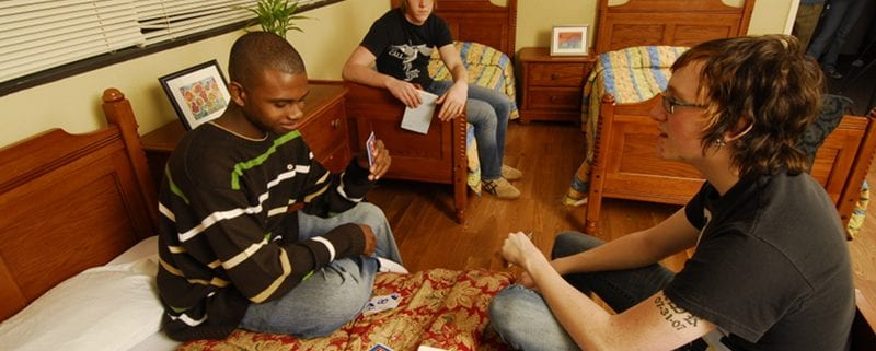 Teens playing cards at Ridgeview